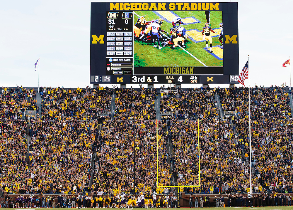 Oct 10, 2015; Ann Arbor, MI, USA; Michigan Wolverines quarterback Jake Rudock (15) indicates a touchdown by running back Derrick Green (27) in the fourth quarter against the Northwestern Wildcats at Michigan Stadium. Mandatory Credit: Rick Osentoski-USA TODAY Sports