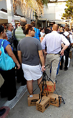 AUG 30 2013 People wait to receive gas-masks in Tel Aviv