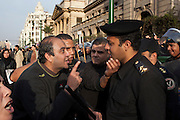 Egyptian protesters try to reason with an Egyptian policeman during continuing January 26, 2011 demonstrations in downtown Cairo, Egypt. A series of unprecedented demonstrations have broken out across Egypt for the past two days, inspired by the revolution in Tunisia, and intended to spark a similar movement in Egypt. (Photo by Scott Nelson)