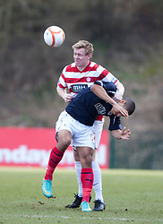 Hamilton's Jonathan Page tackles Falkirk's Lyle Taylor..Hamilton 1 v 2 Falkirk, Scottish Cup quarter-final, Saturday, 2nd March 2013..©Michael Schofield.