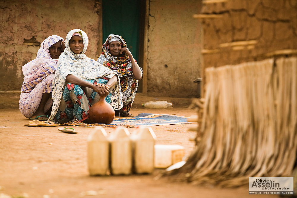 Refugee women from Central African Republic sit on the ground in the village of Boulembe, near Bertoua, Cameroon, on Tuesday September 15, 2009..