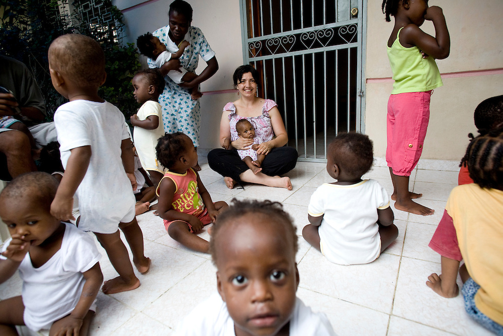 Jocelyne Perret, adopting mother, at her daughter's orphanage on the outskirts of Port-Au-Pince. Perret is holding her daughter Judith who is turning one on Saturday. Perret is hoping that David Koubbi and Emmanuelle Guerry's work will help Edith get her passport quickly. Perret has been in the process of adopting Edith since August 2009.