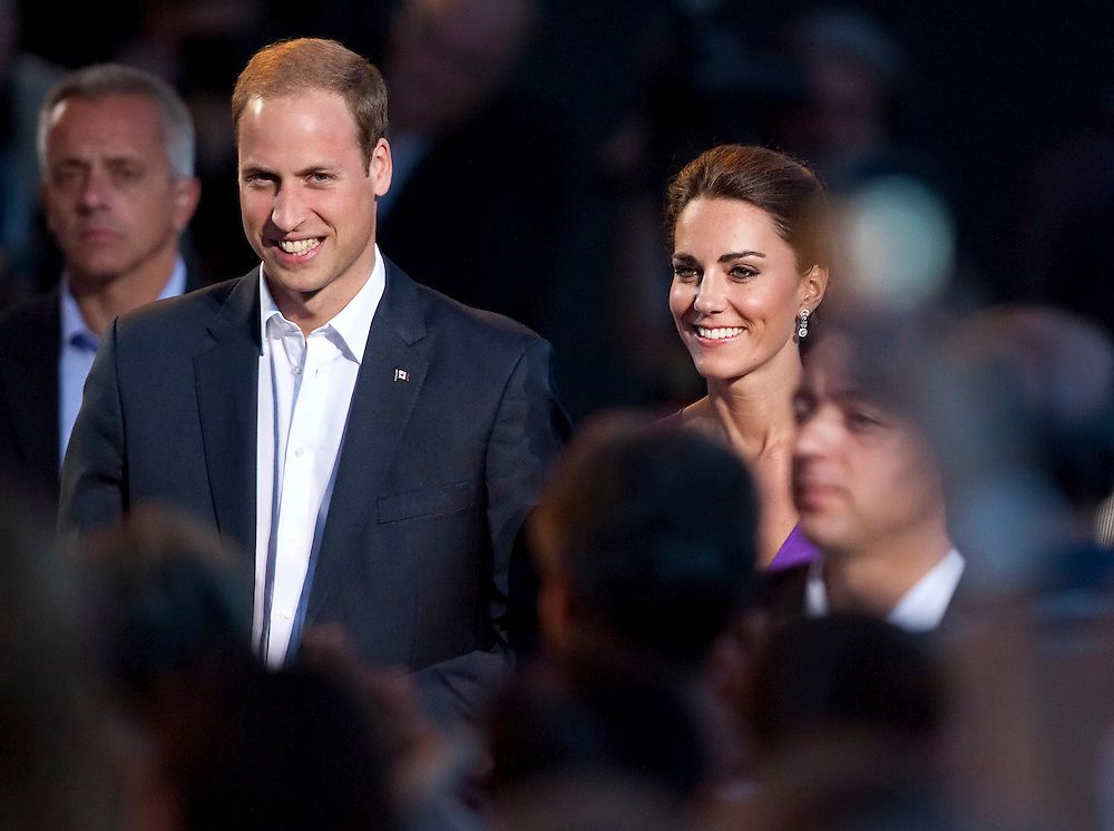 Britain's Prince William and his wife Catherine the Duchess of Cambridge arrive on  Parliament Hill in Ottawa, Canada, July 1, 2011 to participate in the evening Canada Day show. The Duke and Duchess are on a nine day tour of Canada, their first official foreign trip as husband and wife.<br /> AFP PHOTO/GEOFF ROBINS