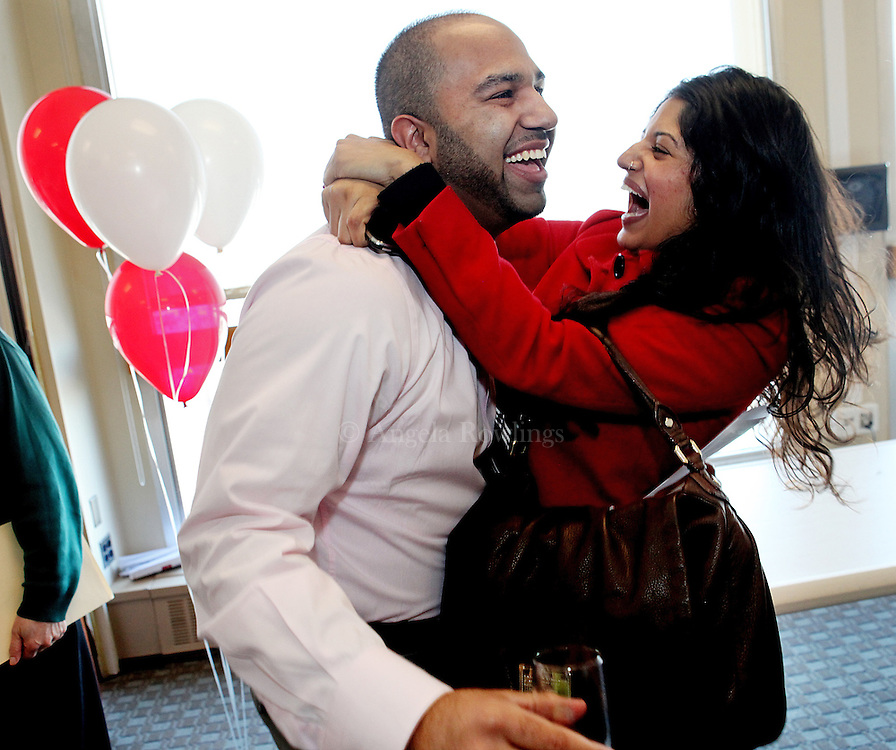 (031711  Boston, MA) Harpeet Singh is embraced by his girlfriend, Sharn Bains after learning he was accepted into UC-Davis's program for anesthesiology during Match Day at Boston University School of Medicine, Thursday,  March 17, 2011.   Staff photo by Angela Rowlings.