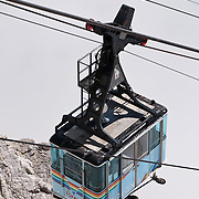 "From the ski resort of Cortina d'Ampezzo, ride a cable car lift to Tofana di Mezzo (3244 meters / 10,643 feet, third highest peak in the Dolomites) in Tofane mountain group, in the Dolomiti (a part of the Southern Limestone Alps), in the Province of Belluno, Veneto region, Italy, Europe. This ski resort hosted the 1956 Winter Olympics and motion pictures including: ""The Pink Panther"" (1963), ""For Your Eyes Only"" (1981, James Bond stunt sequences); and ""Cliffhanger"" (1993). Here at the head of Valle del Boite, nearby peaks include Pomagagnon to the north, Cristallo to the northeast, Faloria and Sorapiss to the east, and Becco di Mezzodì, Croda da Lago and Cinque Torri to south. The Dolomites were declared a natural World Heritage Site (2009) by UNESCO."