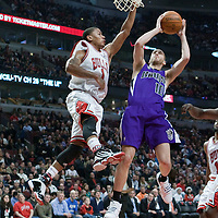 21 December 2009: Sacramento Kings guard Sergio Rodriguez takes a jumpshot against Chicago Bulls guard Derrick Rose during the Sacramento Kings 102-98 victory over the Chicago Bulls at the United Center, in Chicago, Illinois, USA.