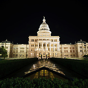 Texas State Capitol in Austin at night. In the foreground are skylights of the new underground addition adding office space to the complex. Completed in 1888 and in an architectural style of Renaissance Revival, the Texas State Capitol is the largest of the state Capitols. Although smaller in size than the US Capitol in Washington DC, it's dome rises 15 feet higher than the US Capitol Dome. On a high point in Austin's downtown, it has a commanding view over the surround area. Its exterior is of locally source granite.