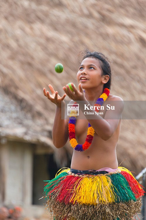 Yapese girls in traditional clothing juggling lemons at Yap Day Festival, Yap Island, Federated States of Micronesia