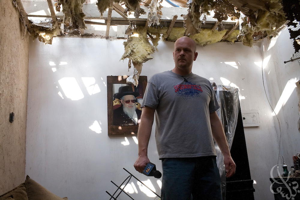 """Samuel J. Wurzelbacher, better known as """"Joe the Plumber"""", works on assignment as a war correspondent reporting from the scene of house damaged recently by a Palestinian rocket attack January 11, 2009 in Sderot, Israel. Wurzelbacher, who rose to fame during the 2008 election after questioning then presidential candidate Barack Obama about his tax plan, is in the region for about 10 days  to report for the conservative web site Pajamas TV (www.pjtv.com.)"""