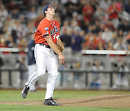 Mississippi's Aaron Greenwood (44) reacts to giving up the game winning hit in the 9th inning against Virginia in the College World Series in Omaha, Neb. on Sunday, June 15, 2014. Virginia won 2-1.