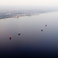 Aerial view of cargo ships at anchor in the Atlantic Ocean near Fort Lauderdale, Florida.