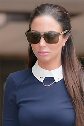 London June 26th 2014. Pop star and former X-Factor judge Tulisa Contostavlos leaves Southwark Crown Court after a hearing relating to the drugs charges she faces as a result of a newspaper sting.