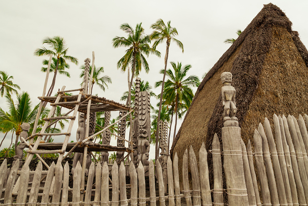 The rebuilt temple of Hale o Keawe in Pu'uhonua o Honaunau (Place of Refuge) National Historic Park in Captain Cook near Kona remains protected by Ki'i, wooden guardians.