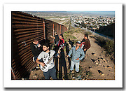 Members of the Reggae and Ska band 'Cantamo' at the border fence in Tijuana, Baja California, Mexico.<br /> <br /> This picture is part of my long-term project<br /> LA FRONTERA: Artists along the US Mexican Border.<br /> &copy; Stefan Falke / www.stefanfalke.com