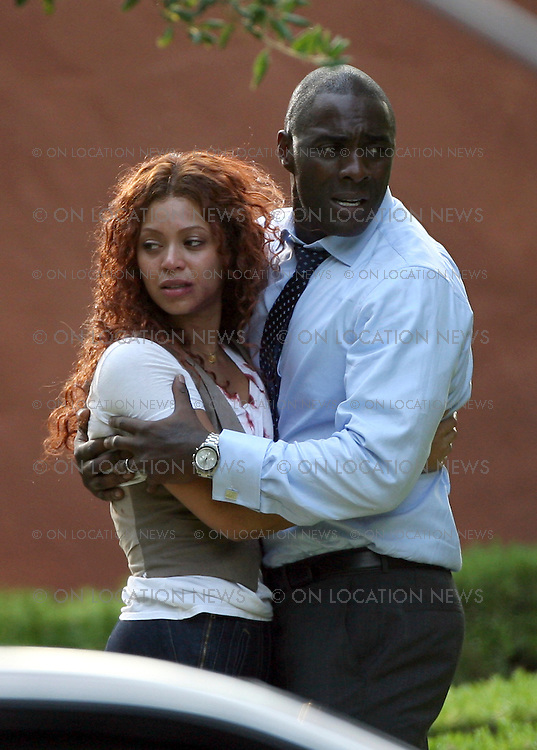 LOS ANGELES, CALIFORNIA - TUESDAY 24th JUNE 2008 EXCLUSIVE: Beyonce Knowles shooting scenes from her new movie 'Obsessed' with her co-star Idris Elba. In this emotional scene Beyonce runs to her car and grabs her child while wearing a T-Shirt that is ripped and covered in blood. Her husband arrives home and they all embrace. Photograph: On Location News. Sales: Eric Ford 1/818-613-3955 info@OnLocationNews.com