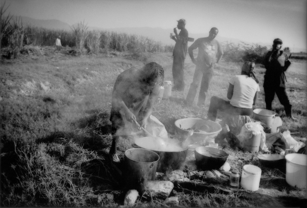 Haitian woman prepares lunch for sugar cane cutters in the fields near Barahona, Dominican Republic.