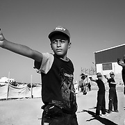 Young Palestinian boys aim wooden practice pistols during a Sunday, August 5, 2007 Hamas sponsored summer camp in the Nuseirat camp in the Gaza strip. Up to 100,000 kids from age 7-16 are given military style training 6 days a week at  Hamas camps across the Gaza strip for 3 hours per day.