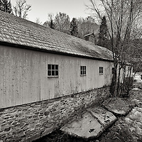 Barn in New Preston, CT next to a rushing stream