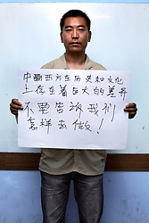 Li Qi Sheng - 30 Yrs.<br /> Computer science teacher from Liaoning Province but learning english in Guangxi Province.<br /> Guangxi Province.<br /> <br /> 'Huge cultural differences exist between the East and the West. Do not tell us what to do'.