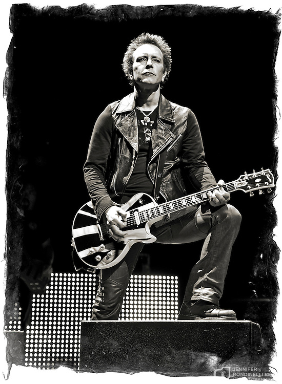 Guitarist Billy Morrison with Billy Idol performing on 6/27/13 during Summerfest at the BMO Harris Pavilion in Milwaukee, Wi.  Photo © 2013 Jennifer Rondinelli Reilly.  All Rights Reserved. No use without permission. Contact me for any reuse.