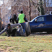 Volunteer Ja'Won Biddle (15) seen working during The Delaware Valley Development Company Inaugural Trash to Cash event Monday, Jan 19, 2015 in Wilmington, Del.