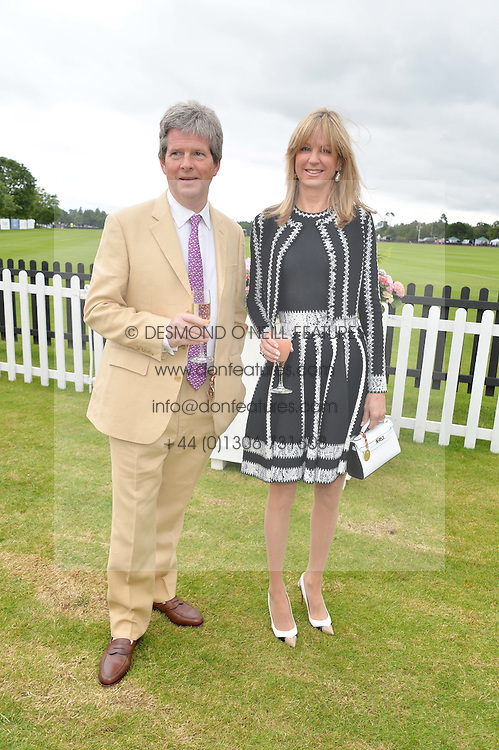 GUY & FIONA SANGSTER at the Cartier Queen's Cup Final polo held at Guards Polo Club, Smith's Lawn, Windsor Great Park, Egham, Surrey on 15th June 2014.