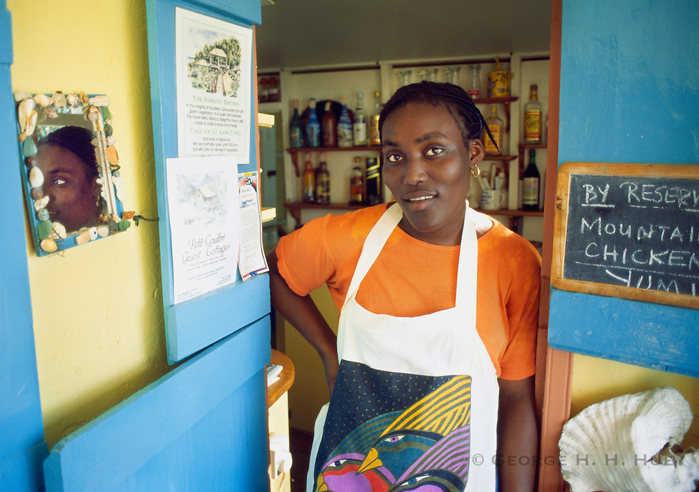 356203-1004D ~ Copyright:  George H. H. Huey ~ Cook and waitress at the Seabird Cafe, in village of Soufriere.  Dominica.  Caribbean.