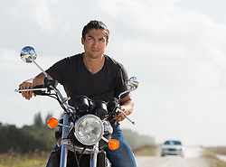 Asian American man on a motorcycle in Florida