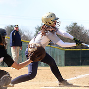 Goldey-Beacom catcher Alivia Schoff (7) makes contact with the ball in the fifth inning of a NCAA Central Atlantic Collegiate Conference game against Post University Saturday, March 30, 2013, at Nancy Churchmann Sawin Athletic Field in Wilmington Delaware.