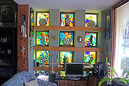 Work by painter Cosme Proenza at his home in Holguin, Cuba.