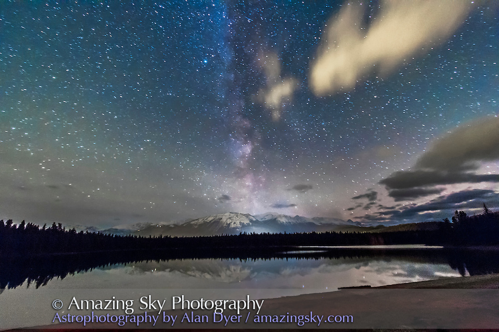 The Milky Way over Lake Annette in Jasper National Park, Alberta, a Dark Sky Preserve. I shot this at the Lake Annette Star Party, one of the Dark Sky Festival events, using the Canon 60Da and 10-22mm lens at 10mm f/4 and ISO 3200 for 1 minute, untracked. Shot October 24, 2014 with fresh snow on Whistler across the lake and valley and on a calm night with still waters reflecting the stars.