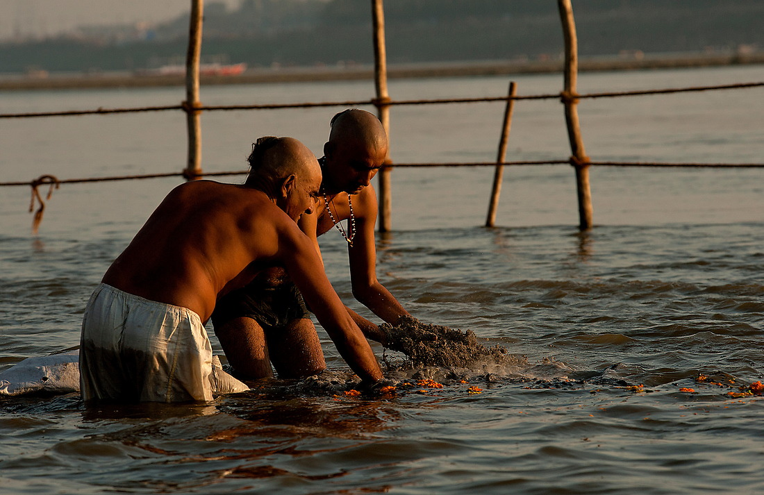 A couple of Hindu pilgrims release the ashes of a loved one into the river Ganges on February 8, 2013 in Allahabad, India during the Kumbh Mela. It is believed, that a dead person will quickly ascend to heaven if his or her ashes are spread upon the river's waters. — © Jeremy Lock/