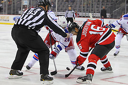Sep 16, 2013; Newark, NJ, USA; New York Rangers center Dominic Moore (28) and New Jersey Devils center Jacob Josefson (16) face off during the first period at Prudential Center.