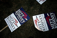 Signs of U.S. Presidential candidate Mitt Romney sit on the ground during the Iowa State Straw Poll August 11, 2007 in Ames, Iowa..