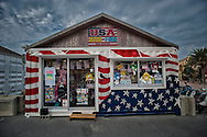 Small temporary shop, plastered with American themes commercialism, set up in American Village set next to the US Air Force Kadena Air Base in Mihama, Okinawa.  Japan.