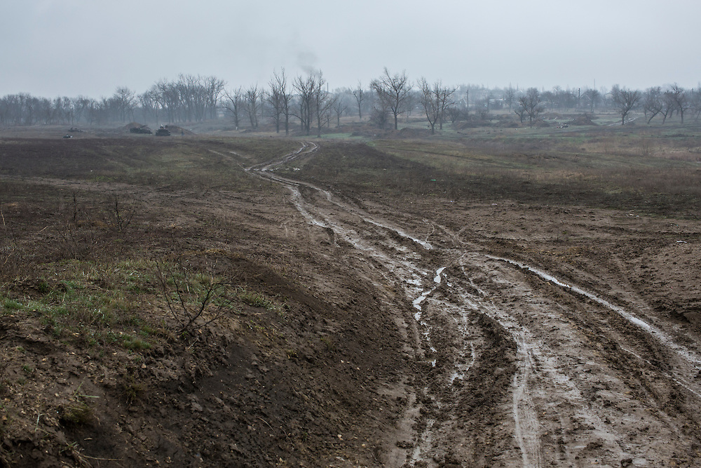 A muddy track divides a field where Ukrainian forces, some of their tanks left behind, were defeated in the battle of Debaltseve more than a year earlier, on Sunday, March 27, 2016 in Debaltseve, Ukraine.