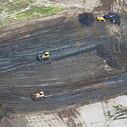 Aerial view of  bull dozers. Catapiller Heavy Equipment moving dirt