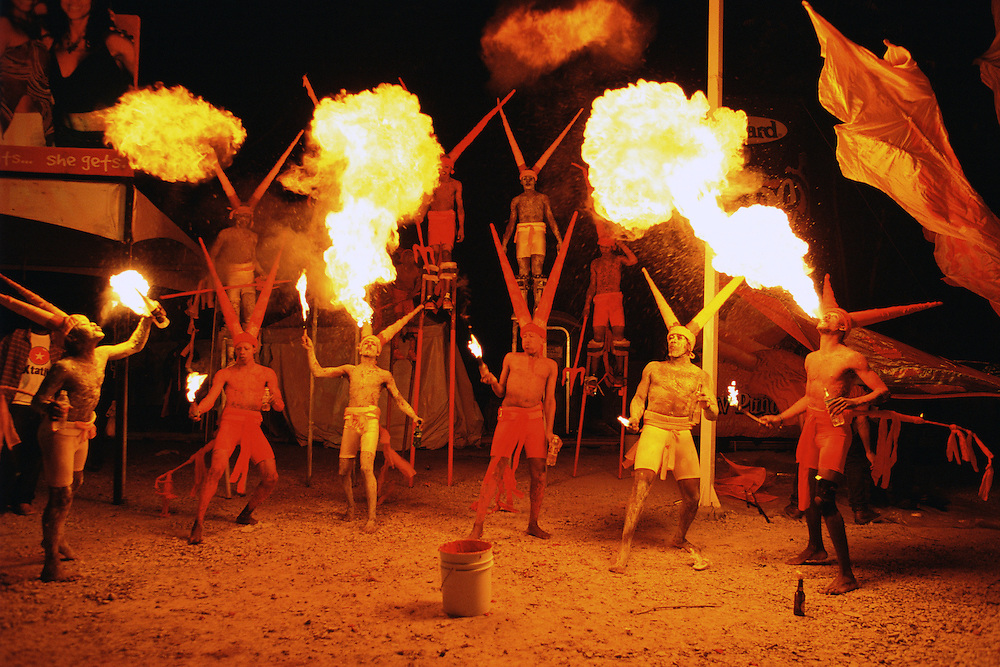 "Trinidad and Tobago ""MOKO JUMBIES: The Dancing Spirits of Trinidad"".(Moko Jumbies in Yellow Devil costumes created by Brian Mac Farlane blow fire at a special presentation for the closing night of Carnival Messiah, a theatrical production at Queens Hall, Port of Spain.).A photo essay about a stilt walking school in Cocorite, Trinidad..Dragon Glen de Souza founded the Keylemanjahro School of Art & Culture in 1986. The main purpose of the school is to keep children off the streets and away from drugs..He first taught dances like the Calypso, African dance and the jig with his former partner Cathy Ann Samuel.  Searching for other activities to engage the children in, he rediscovered the art of stilt-walking, a tradition known in West Africa as the Moko Jumbies , protectors of the villages and participants in religious ceremonies. The art was brought to Trinidad by the slave trade and soon forgotten..Today Dragon's school has over 100 members from age 4 and up..His 2 year old son Mutawakkil is probably the youngest Moko Jumbie ever. The stilts are made by Dragon and his students and can be as high as 12-15 feet. The children show their artistic talents mostly at the annual Carnival, which today is unthinkable without the presence of the Moko Jumbies. A band can have up to 80 children on stilts and they have won many of the prestigious prizes and trophies that are awarded by the National Carnival Commission. Designers like  Peter Minshall , Brian Mac Farlane and Laura Anderson Barbata create dazzling costumes for the school which are admired by thousands of  spectators. Besides stilt-walking the children learn the limbo dance, drumming, fire blowing and how to ride  unicycles..The school is situated in Cocorite, a suburb of Port of Spain, the capital of Trinidad and Tobago..all images © Stefan Falke"