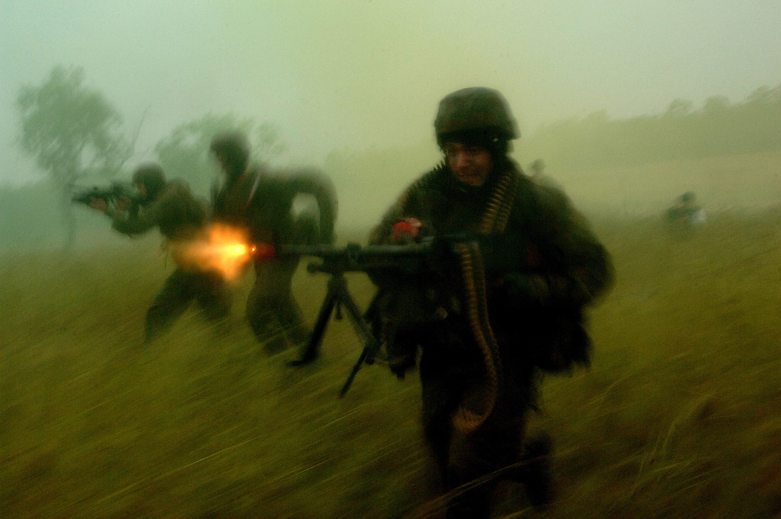 Australian soldiers fire on the opposing force as they gain on their attack on Camp Raspberry. — © Tsgt Jeremy Lock/