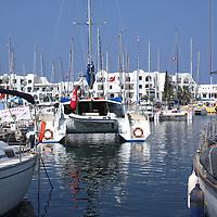 Boats, pleasure and working fishing boats, at the marina at El Kantouai, Tunisia, catamaran