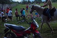 Junco do Maranhao, Brazil, June 25 of 2013:  Bolsa Familia em Junco do Maranhao. Moradores passam o tempo assistindo pelada de futebol. (photo: Caio Guatelli)