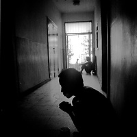 BEIJING, AUGUST-26: a patient sits in the hallway in a privatley run mental institution in Beijing.