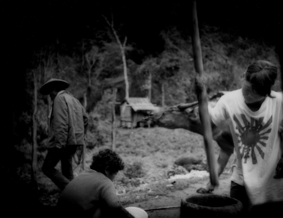 Girl, the daughter of a Filipino man and a Negrito woman, pounds rice, Sawa, Sierra Madre Mountains, Luzon, Philippines.  Intermarriage is not uncommon between Negritos and Filipinos.