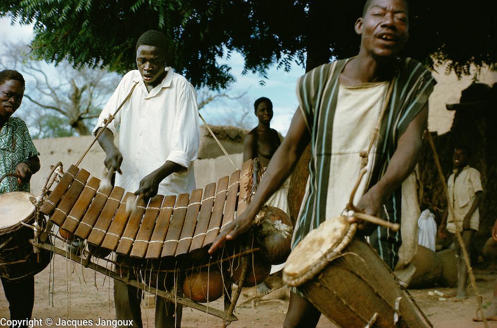 Musicians of Bobo tribe playing drums and balafon xylophone in Koumbia, Burkina Faso, Africa.