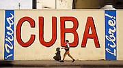 MARCH 19, 2001 - HAVANA, CUBA:  A student walks past a billboard in the old section of  Havana, Cuba, March 19, 2001.      PHOTO BY  JACK KURTZ     CHILDREN  EDUCATION  CULTURE