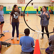Katie Wartella, A14, of the Tufts Quidditch Team, goes over the rules of the game before hosting a match for the members of the Medford Boys and Girls Club. (Kelvin Ma/Tufts University)