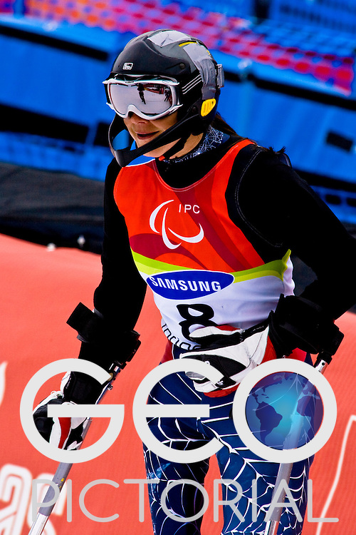 SESTRIERE COLLE, ITALY - MARCH  18th : Sandy Dukat (LW2) of the USA finishes her second run of the Womens Alpine Skiing Slalom Standing competition on Day 9 of the 2006 Turin Winter Paralympic Games on March 16th, 2006 in Sestriere Borgata, Italy.