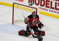 Jan 2, 2009; Newark, NJ, USA; New Jersey Devils goalie Scott Clemmensen (35) makes a save during the third period at the Prudential Center.  The Devils defeated the Canadiens 4-1.