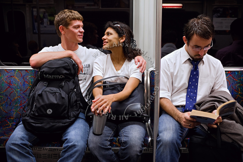 Ross Caputi, 27, (right) is talking to his his wife, Dahlia Wasfi, 40, whose father is Iraqi, in Boston's subway train, MA, USA. Ross just completed a course in linguistics from Boston University. He was a radio operator for his company in Fallujah in 2004, during the battles. After leaving the Marines, he turned to anti-war activism. Ross runs a project called 'Justice for Fallujah', which aims at raising awareness about the problems in Fallujah since the 2004 US-led battles, and about the wrongs of war, after having witnessed them first-person as a soldier in Iraq.