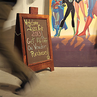 Event participant walks by welcome sign at the 2013 NYC Winter Jazz Fest held in Greenwich Village in New York City, Friday, January 11, 2013.